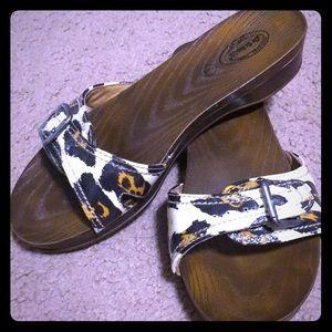 Gently worn leopard slides